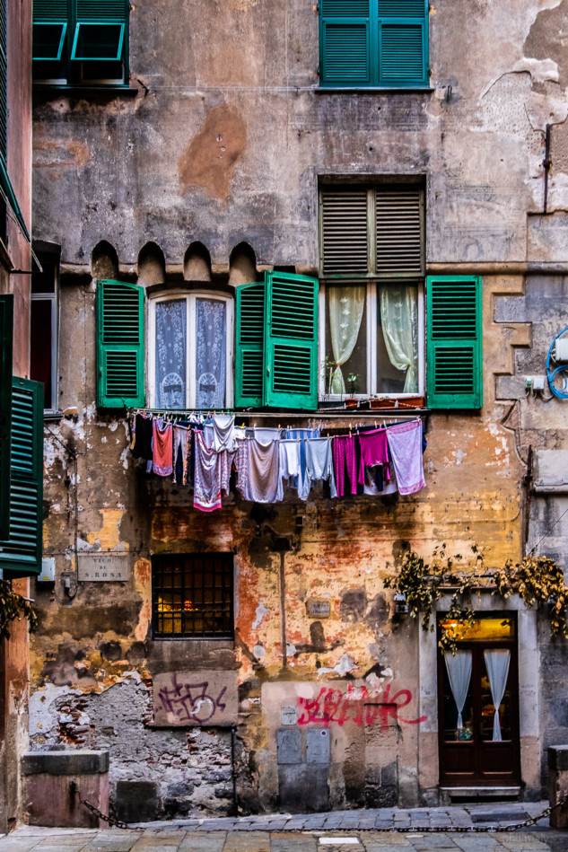Old colorful house with laundry hanging outside the windows
