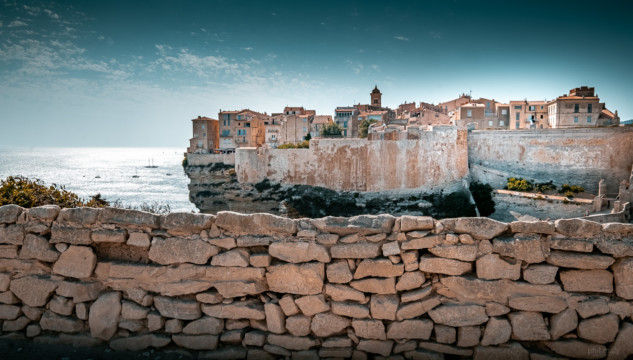 The beautiful city of Bonifacio with a stone wall in the foreground