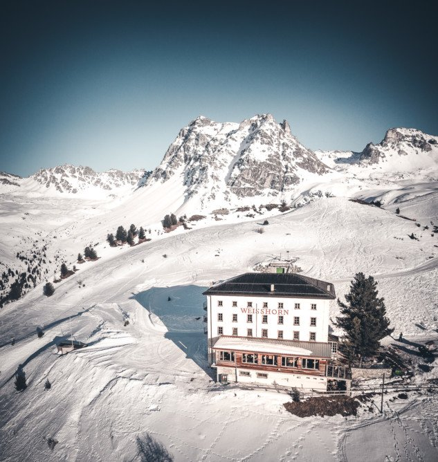 The famous Weisshorn hotel overlooking the village of Saint-Luc